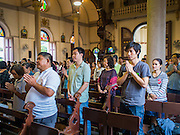 15 FEBRUARY 2015 - BANGKOK, THAILAND:  Sunday mass at Santa Cruz Catholic Church in the Kudeejeen neighborhood in Bangkok. Santa Cruz church was established in 1770  and is one of the oldest and most historic Catholic churches in Thailand. The church was originally built by Portuguese soldiers allied with King Taksin the Great. Taksin authorized the church as a thanks to the Portuguese who assisted the Siamese during the war with Burma. Most of the Catholics in the neighborhood trace their family roots to the original Portuguese soldiers who married Siamese (Thai) women. There are about 300,000 Catholics in Thailand in about 430 Catholic parishes and about 660 Catholic priests in Thailand. Thais are tolerant of other religions and although Thailand is officially Buddhist, Catholics are allowed to freely practice and people who convert to Catholicism are not discriminated against.     PHOTO BY JACK KURTZ