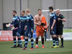 Forfar Athletic's keeper Grant Adam gives his top to Forfar Athletic's Martin Fotheringham after his red card. Clyde 2 v 2 Forfar Athletic, Scottish League Two game played 4/3/2017 at Clyde's home ground, Broadwood Stadium, Cumbernauld.
