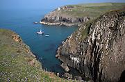 Navigation beacon and fishing boat, Porthgain, Pembrokeshire, Wales, UK