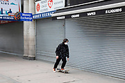Skateboarders wearing face masks pass closed down souvenir tourist shops at Piccadilly, which is eerily quiet and silent on empty streets as lockdown continues and people observe the stay at home message in the capital on 12th May 2020 in London, England, United Kingdom. Coronavirus or Covid-19 is a new respiratory illness that has not previously been seen in humans. While much or Europe has been placed into lockdown, the UK government has now announced a slight relaxation of the stringent rules as part of their long term strategy, and in particular social distancing.