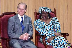 The Duke of Edinburgh sits with Nana Rawlings, wife of Ghana's President Flight Lieutenant Jerry Rawlings.