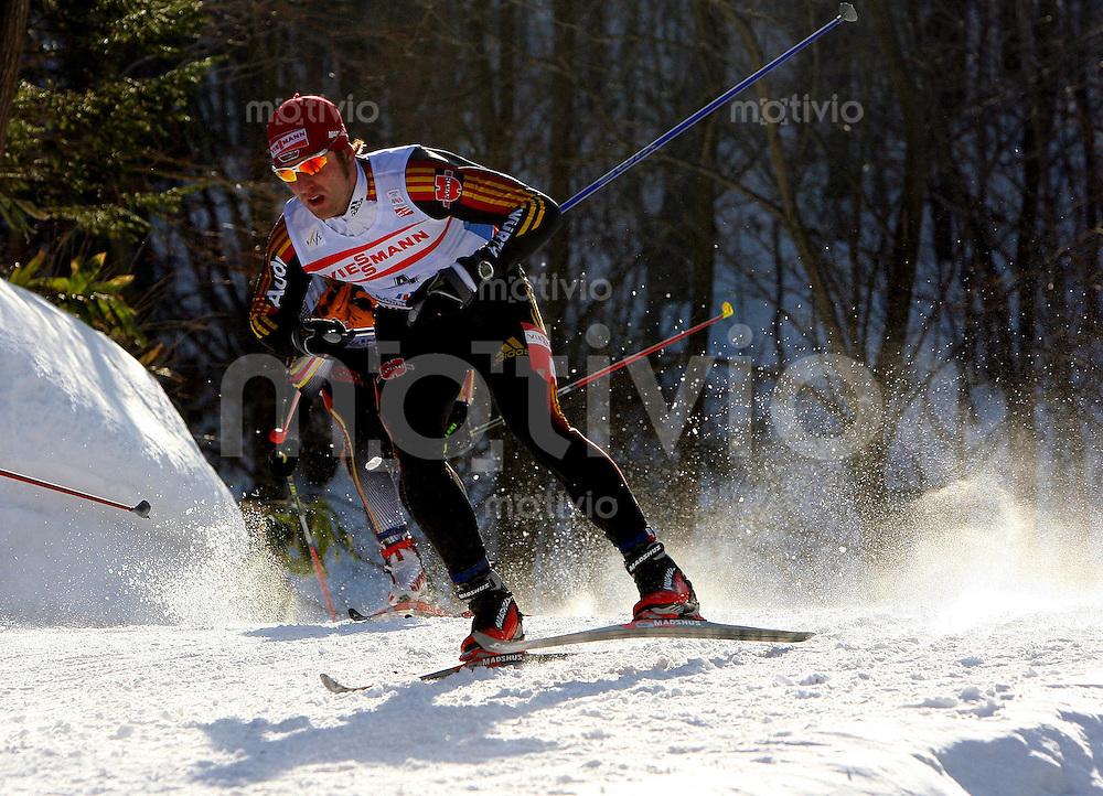 Sapporo , 240207 , Nordische Ski Weltmeisterschaft  Langlauf Verfolgung Maenner ,  Axel TEICHMANN (GER) in der Loipe