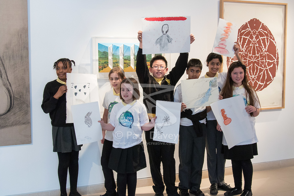 Christies, St James, London, March 4th 2016. Pupils from Charlton Manor Primary School show their creations at the preview for the It's Our World charity auction at Christie's. Over 40 leading artists including David Hockney, Sir Antony Gormley, David Nash, Sir Peter Blake, Yinka Shonibare, Sir Quentin Blake, Emily Young and Maggi Hambling have committed artworks to the It's Our World Auction in support of The Big Draw and Jupiter Artland Foundation, to be sold at Christie's London on 10 March 2016.<br />  ///FOR LICENCING CONTACT: paul@pauldaveycreative.co.uk TEL:+44 (0) 7966 016 296 or +44 (0) 20 8969 6875. ©2015 Paul R Davey. All rights reserved.