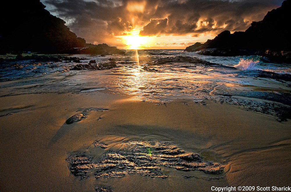 The sun rises at 'From Here to Eternity' Beach on Oahu.