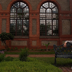 """Asheville's own Alice Witchel sits on a bench outside the Biltmore Estate's conservatory, while visiting with out-of-town family. """"It's a nice place to watch the world,"""" she said.."""