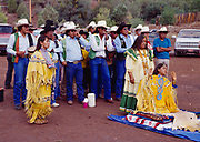 Godmother Phoebe Cromwell with Carla Goseyun, Carmin Goseyun and the Burnette Singers to left and behind, Carla Goseyun's White Mountain Apache Traditional Sunrise Ceremony, Whiteriver, Arizona.  Please Note: A small extra licensing fee needs to be paid to the Goseyun Family for usage of this photo. Contact Fred Hirschmann for more information. Thanks.