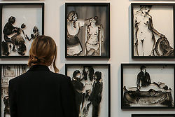 © Licensed to London News Pictures. 21/01/2020. London, UK. A woman views a series paintings by Hona Szalay  during the preview of London Art Fair at Business Design Centre in north London. The fair opens on 22 January and runs until 26 January, which showcases modern and contemporary artwork from galleries around the world. Photo credit: Dinendra Haria/LNP