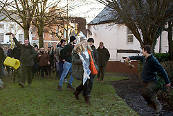 © Licensed to London News Pictures. 2/1/2016. Atherstone, North Warwickshire, UK. The annual New Year meet of the Atherstone Hunt took place in the market square earlier today. Anti-Hunt protesters were also in the square and the Police were called after scuffles broke out during the meet. A police helicopter monitored the situation as the protestors sought sanctuary in a nearby car park, whilst waiting for the arrival of Police on foot. Protestors trying to leave the Market Square are taunted by people waving fox tails. Photo credit: Dave Warren/LNP