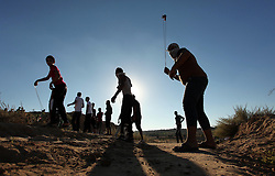 September 30, 2016 - Bureij, Gaza Strip, Palestinian Territory - Palestinian protesters use a slingshot to hurl stones toward Israeli security forces during clashes near the border between Israel and Central Gaza Strip east of Bureij on Sep. 30, 2016  (Credit Image: © Ashraf Amra/APA Images via ZUMA Wire)