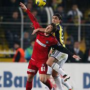 Fenerbahce's Mehmet Topuz (R) and Gaziantepspor's Orhan Gulle (L) during their Turkish superleague soccer match Fenerbahce between Gaziantepspor at the Sukru Saracaoglu stadium in Istanbul Turkey on Monday09 January 2011. Photo by TURKPIX