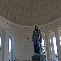 Tourists stand below a huge statue of Thomas Jefferson at the Jefferson Memorial in Washington, D.C.