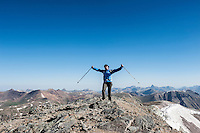 Female hiker on summit of Handies peak (14053 ft), San Juan mountains, Colorado, USA