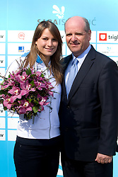 Sara Isakovic, Slovenian swimmer with Borut Farcnik when her sponsor Zavarovalnica Triglav d.d. decided to rebuild children playground, on March 22, 2012, in Notranje Gorice, Slovenia. (Photo by Vid Ponikvar / Sportida.com)