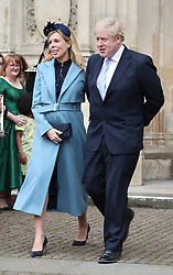 Prime Minister Boris Johnson and partner Carrie Symonds leaving after the Commonwealth Service at Westminster Abbey, London on Commonwealth Day. The service is the Duke and Duchess of Sussex's final official engagement before they quit royal life.