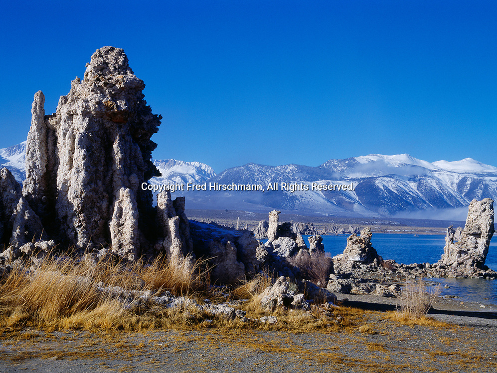 Tufa along the shore of Mono Lake with snow-capped Sierra Nevada beyond, South Tufa Area, Mono Lake Tufa State Reserve and Mono Basin National Forest Scenic Area, Inyo National Forest, California.