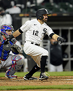 CHICAGO - APRIL 24:  Adam Eaton #12 of the Chicago White Sox bats against the Texas Rangers on April 24, 2021 at Guaranteed Rate Field in Chicago, Illinois.  (Photo by Ron Vesely) Subject:  Adam Eaton