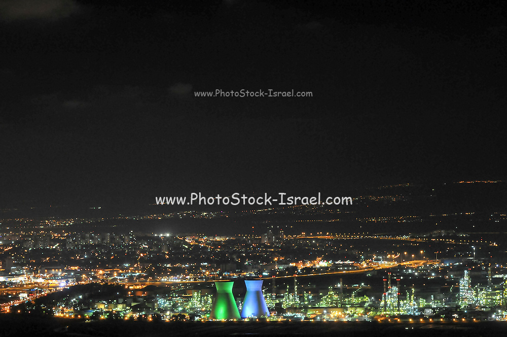 Israel, Haifa bay at night the cooling towers of the oil refinery