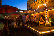 Pau Hana, meaning finished with work, at 39 Hotel, an upstairs, outdoor bar on Hotel Street on the outskirts of Chinatown in downtown Honolulu, Hawaii, Oahu