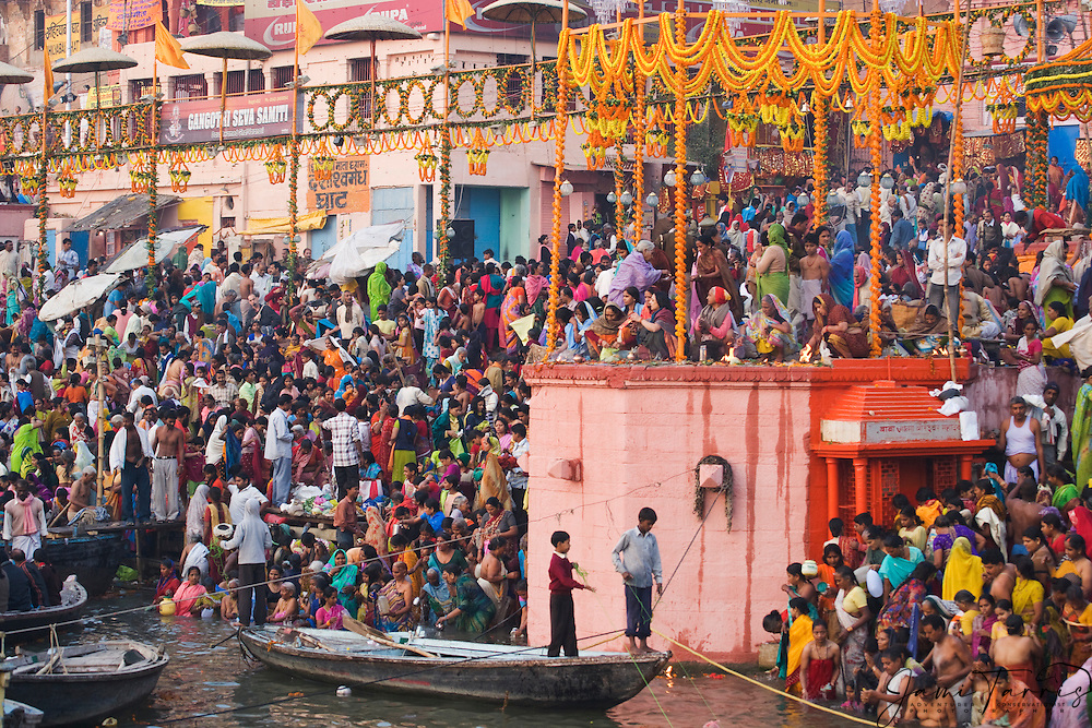 Early morning bathing at the steps of Dasaswamedh ghat in Varanasi, Varanasi, Uttar Pradesh, India