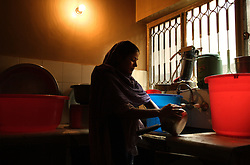 Maryam, 18, is seen doing the dishes at Dastak, a shelter opened in 1990 for abused women seeking refuge by the AGHA Legal Aid Cell, Lahore, Pakistan, May 2, 2005. Maryam is a rape victim who was jailed for seven months for having sexual intercourse. Her father married her off to a man and then accused him of rape as a revenge against him. For the last 10 months Maryam has lived at the shelter. She is now employed there as a cook and cleaner until she kind find a better alternative.