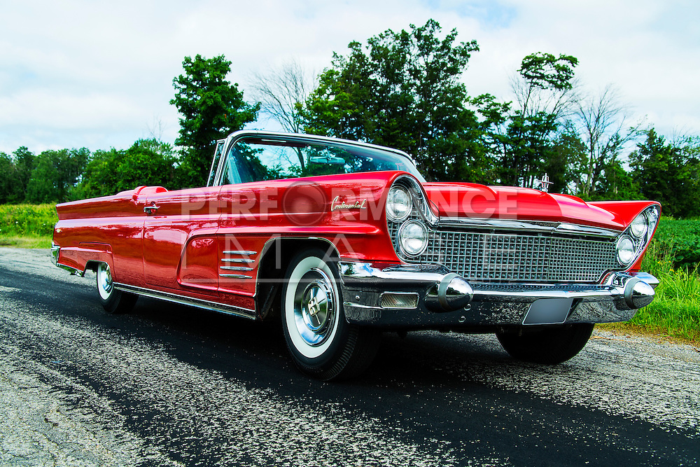 1960 Lincoln Continental Convertible on roadway