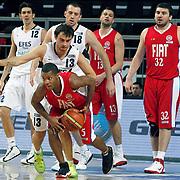 Efes Pilsen's Kerem GONLUM (B), Ender ASLAN (L), Nikola VUJCIC (C) and Tofas's Jason ROWE (F), Onur AYDIN (R), Tomislav RUZIC (B) during their Turkish Basketball league match Efes Pilsen between Tofas at the Sinan Erdem Arena in Istanbul Turkey on Sunday 27 February 2011. Photo by TURKPIX