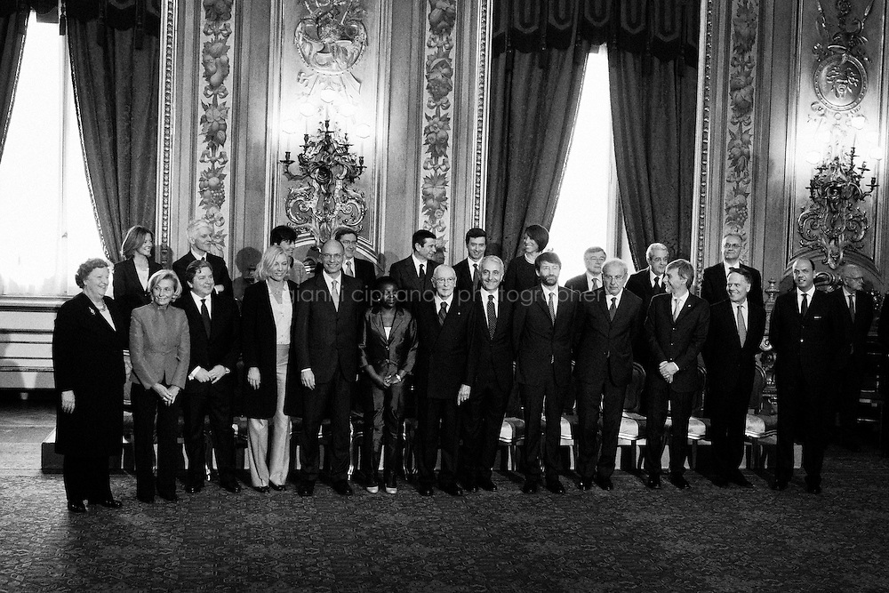 ROME, ITALY - 28 APRIL 2013: Members of the new Italian government pose with President Giorgio Napolitano (C) and new Italian Prime Minister Enrico Letta (5th,L) during the swearing in ceremony of the new government at Quirinale palace on April 28, 2013 in Rome, Italy. The new coalition government was formed through extensive cooperation agreements between the right and left coalitions, after a two-month long post-election deadlock.