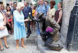 The Duchess of Cornwall receives a kiss on her hand during a guided tour of Old Havana, in Havana, Cuba.