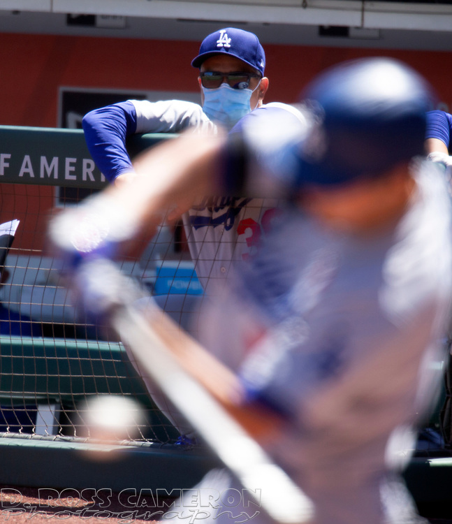 Los Angeles Dodgers manager Dave Roberts (30) watches the action during the third inning of a baseball game against the San Francisco Giants on Thursday, Aug. 27, 2020 in San Francisco, Calif. (D. Ross Cameron/SF Chronicle)