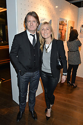 TV presenter FIONA PHILLIPS and her husband MARTIN FRIZELL at a party to celebrate the Astley Clarke & Theirworld Charitable Partnership held at Mondrian London, Upper Ground, London on 10th March 2015.