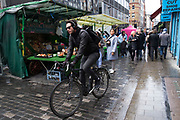 Cycling along Berwick Street in Soho in London, England, United Kingdom. (photo by Mike Kemp/In Pictures via Getty Images)