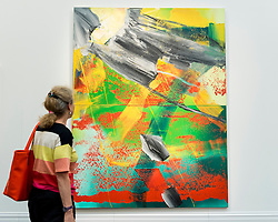 "© Licensed to London News Pictures. 30/09/2016. London, UK.  ""Garten"" by Gerhard Richter (est. GBP3-4million) is viewed by a visitor at the preview of Sotheby's London upcoming Contemporary Art Auctions.  Photo credit : Stephen Chung/LNP"