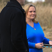 Carrie Kassman, daughter of the late Randy Hockabout talks to Ryan Burris during a ceremony to remember his life at Optimist Park, where his body was found on January 25, 1986. The homicide has remained unsolved and Hockabout's family have launched new efforts to solve the crime including using facebook to find leads. (Jason A. Frizzelle)