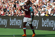 Michail Antonio of West Ham United pulls up with a hamstring injury. Premier league match, West Ham Utd v Swansea city at the London Stadium, Queen Elizabeth Olympic Park in London on Saturday 8th April 2017.<br /> pic by Steffan Bowen, Andrew Orchard sports photography.