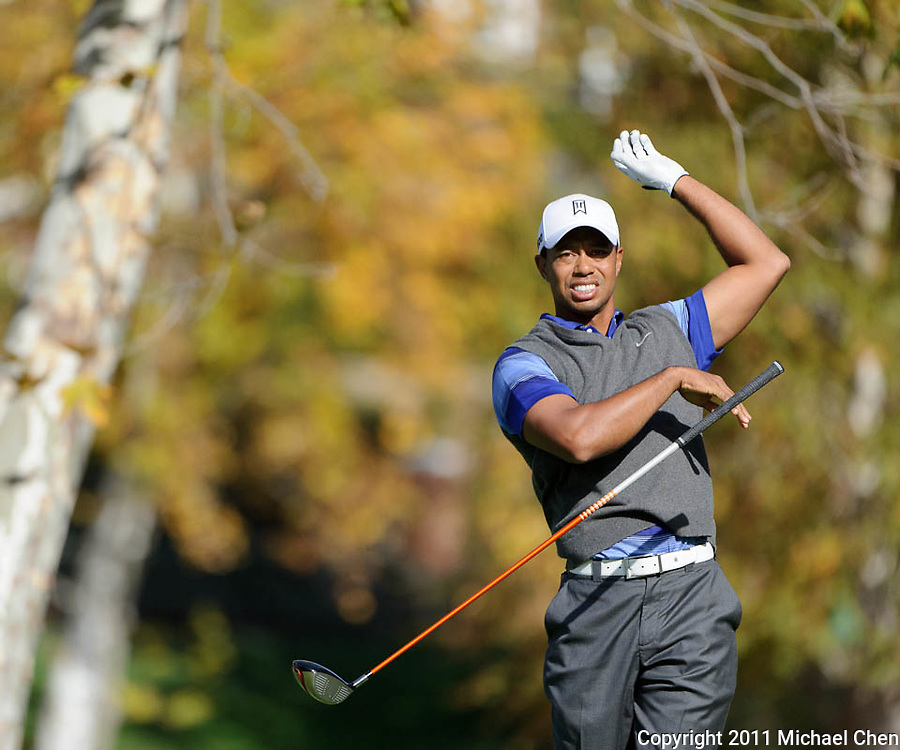 Tiger Woods loses his club following his tee shot on hole 5 during Round 2 of the 2011 Chevron World Challenge at the Sherwood Country Club in Thousand Oaks, Calif., on Friday, Dec. 2, 2011.