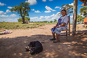 2014/11/22 – Quimili, Argentina: Simone Dominguez (67) sits outside her house in the allotment number 5 of the Guaycurú Indigenous Community. She complains that planes used to pulverize her house with glyphosate, in order to make her feel unsafe and abandon her land. The indigenous people in the area are being threaten by soya producers that see their land as an opportunity to grow more of the crop. On the otherhand indigenous defend a sustainable agriculture and to live in harmony with the nature. (Eduardo Leal)
