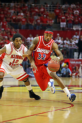 24 March 2008: Marcus Johnson cuts past Dominick Johnson. The Flyers of Dayton defeated the Redbirds of Illinois State 55-48 on Doug Collins Court inside Redbird Arena in Normal Illinois.