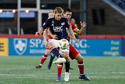 September 22, 2018 - Foxborough, MA, U.S. - FOXBOROUGH, MA - SEPTEMBER 22: New England Revolution midfielder Scott Caldwell (6) plays the ball wrapped up by Chicago Fire midfielder Brandt Bronico (13) during a match between the New England Revolution and the Chicago Fire on September 22, 2018, at Gillette Stadium in Foxborough, Massachusetts. The teams played to a 2-2 draw. (Photo by Fred Kfoury III/Icon Sportswire) (Credit Image: © Fred Kfoury Iii/Icon SMI via ZUMA Press)