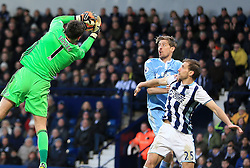 4 February 2017 - Premier League - West Bromwich Albion v Stoke City -Ben Foster of West Bromwich Albion claims as Peter Crouch of Stoke City and Craig Dawson of West Bromwich Albion contest the ball - Photo: Paul Roberts / Offside