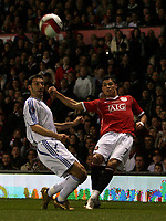 Photo: Paul Thomas.<br /> Manchester United v Europe XI. Friendly match. 13/03/2007.<br /> <br /> Cristiano Ronaldo (R) of Utd crosses in-front of Gianluca Zambrotta.