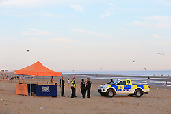 File photo dated 24/8/16 of police officers on Camber Sands near Rye, East Sussex after five young men died, as an inquest is due to open into the deaths of the friends who drowned during a day trip to a popular south coast beach last summer.