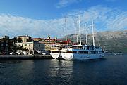 Two large boats moored off Korcula old town, island of Korcula, Croatia