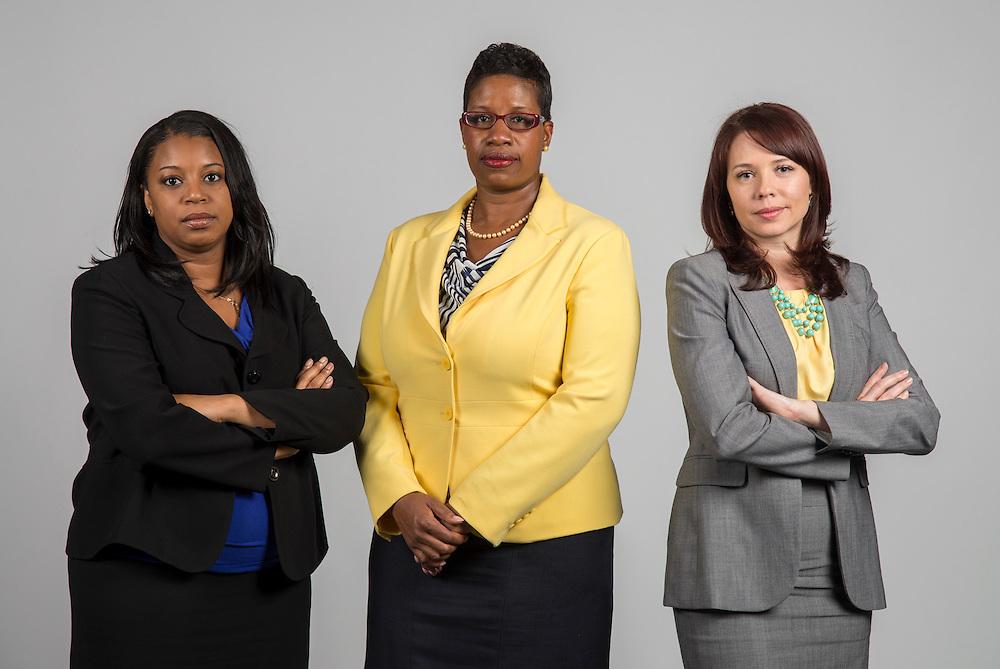 Catosha Woods, left, Erica Graham, center, and Katheryne MarDock pose for a photograph, August 1, 2013.