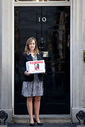 © Licensed to London News Pictures. 16/09/2013. London, UK. Paula Barrow, a 45 year old mother of two from Manchester, stands on the step of Number 10 Downing Street in London today (16/09/2013) as she delivers a petition calling for a 'Daniel's Law. The petition, which is still open and gathering signatures, asks for a law calling for the mandatory reporting of suspected child abuse by those working with children and is named in the memory of Daniel Pelka, a four year old who starved and beaten for months before he died. Photo credit: Matt Cetti-Roberts/LNP