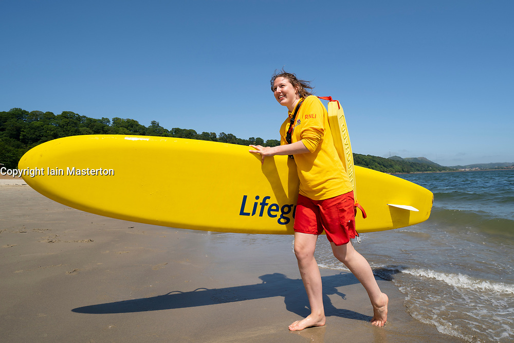 Aberdour, Fife, Scotland, UK. 28 June, 2019. Lifeguard Anna Whyte from Kinghorn in Fife was kept busy at Silver Sands Beach at Aberdour as warm weather and sunshine attracted dozens of people to the seaside. When she is not on duty as a lifeguard , Anna is also a volunteer with the local RNLI lifeboat.