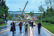 London, United Kingdom, May 22, 2021: About 50+ protestors gathered outside McDonalds distribution centre in Hemel Hempstead Industrial Estate in North London on the early morning of Saturday, May 22, 2021 - to blockade the site for at least 24 hours, using trucks and bamboo structures, causing a significant disruption to the McDonald's supply chain. (Photo by Vudi Xhymshiti)