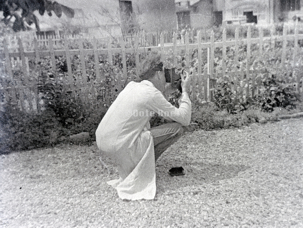 young person taking photograph vintage 1900s
