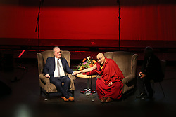 The Dalai Lama with Richard Moore as he addresses a charity event marking the 20th anniversary of the charity Children in Crossfire to celebrate 20 years of the ground-breaking organisation's work, at the Millennium Forum, during a visit to Londonderry.