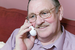 Older man talking on the telephone,