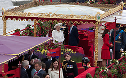 © Licensed to London News Pictures. 03/06/2012. .London, England. .Her Majesty The Queen onboard the Royal Barge Gloriana at The Thames river pageant. The Royal Jubilee celebrations. Great Britain is celebrating the 60th  anniversary of the countries Monarch HRH Queen Elizabeth II accession to the throne this weekend Photo credit : LNP